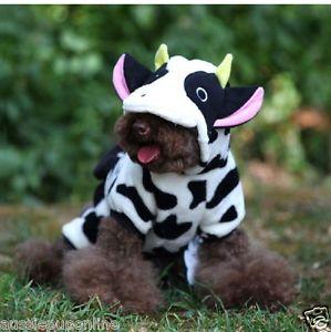 hond in koe onesie